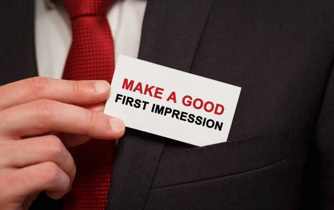 businessman-putting-a-card-with-text-make-a-good-first-impression