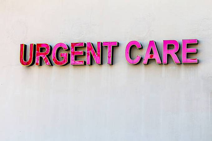 red-urgent-care-sign-on-beige-wall