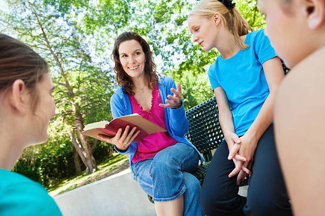 mom-or-mentor-leading-bible-study-with-group-of-girls