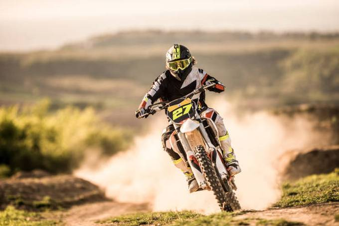 man-on-dirt-bike-racing-on-dirt-road-in-nature