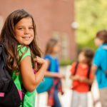 back-to-school-elementaryage-children-girl-on-school-campus